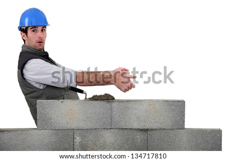 Bricklayer with copyspace - stock photo