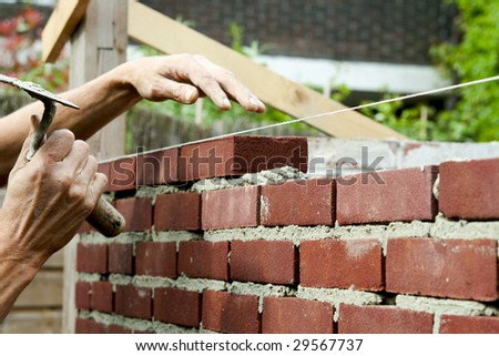 Bricklayer with trowel in hand - stock photo