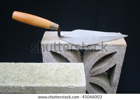 Bricklaying trowel on block.
