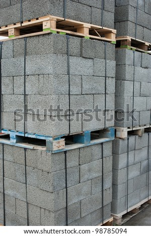 Bricks and blocks stacked on pallets - stock photo