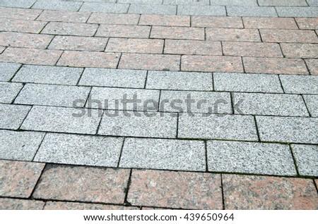 Bricks and stones city pavement pattern, road texture - stock photo