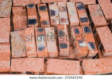 Bricks for new house stacked neatly on top of each other. - stock photo