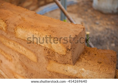 Bricks made of clay soil to build houses, houses built from nature.