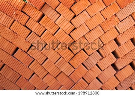 Bricks stacked in piles /Bricks background - stock photo