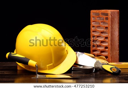 Bricks, trowel and helmet on work place