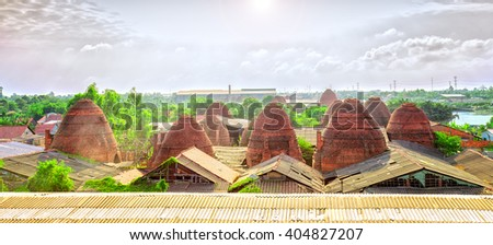 Brickyard village panoramic view from above with dozens brick kiln rise as giant mushroom in sky beautiful sunny morning, this very constructive effort workers in craft villages in Vinh Long, Vietnam