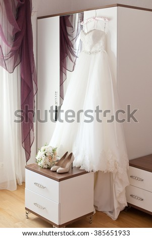 Bridal accessories: wedding dress, shoes and bride's bouquet