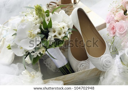 Bridal bouquet and bride shoes.