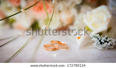 bridal bouquet and rings - stock photo