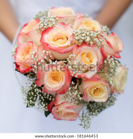 Bridal bouquet. Beautiful bouquet in hands of bride