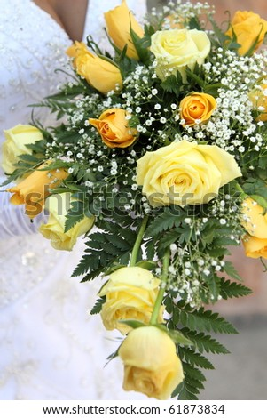 Bridal bouquet close up, yellow flowers and roses - stock photo