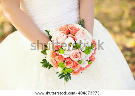 bridal bouquet from roses of pink color in hands