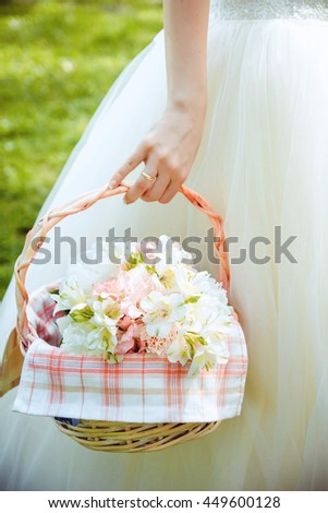Bridal bouquet in the basket.