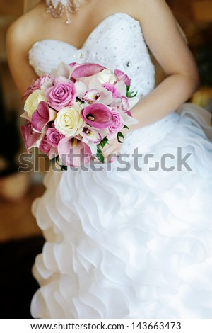 Bridal Bouquet in the bride hands