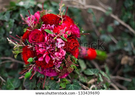 Bridal bouquet lying in a green grass - stock photo