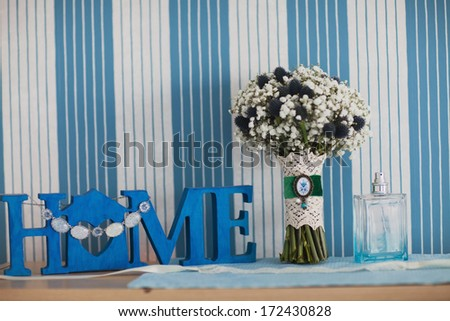 bridal bouquet of Gypsophila and home plate - stock photo