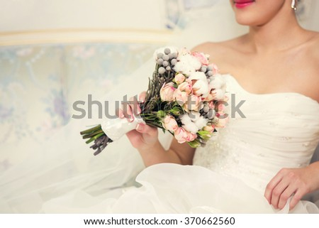 bridal bouquet of pink color in hands