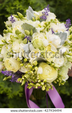 Bridal bouquet of white and violet flovers - stock photo