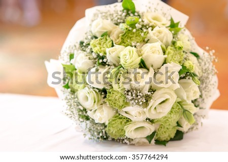 Bridal bouquet of white rose in bright colors - stock photo