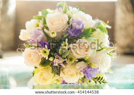 Bridal bouquet on glasses table