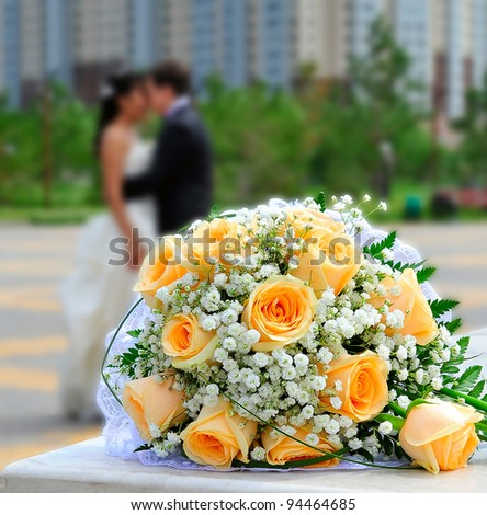 bridal bouquet on the background of the bride and groom