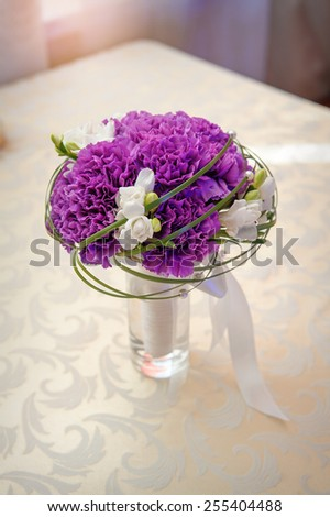 bridal bouquet on the table of violet flowers. - stock photo