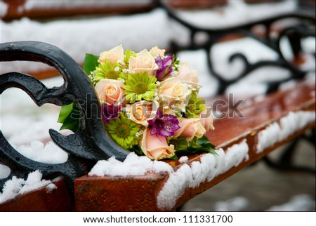 bridal bouquet, wedding bouquet in the snow - stock photo