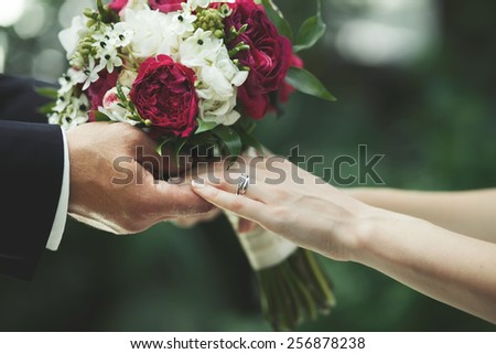 Bridal couple holding hands, groom and bride symbol of  togetherness. - stock photo