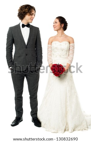 Bridal couple lost in each other. All on white background. - stock photo