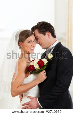 Bridal couple on the wedding day deeply in love