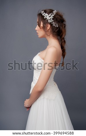 Bridal fashion. Brunette bride in wedding dress and beaded headpiece. - stock photo