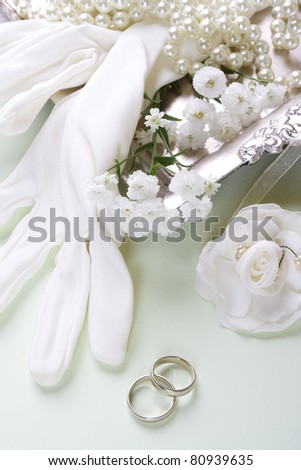 Bridal gloves and vintage accessories with wedding bands. Romantic wedding background, still life. - stock photo