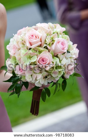 bridal wedding bouquet of flowers in white, pink, and green