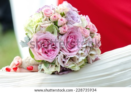 Bridal wedding bouquet with pink roses