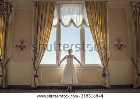 bride against a window indoors