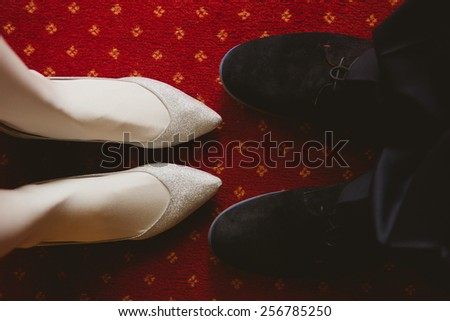 Bride's and groom's shoes on carpet. wedding background - stock photo