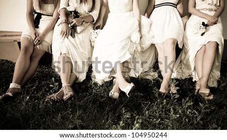 Bride and bridesmaids legs - stock photo