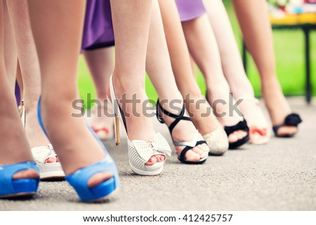 bride and bridesmaids outdoors. Feet