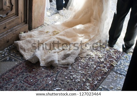 bride and groom as they exit from the ceremony - stock photo