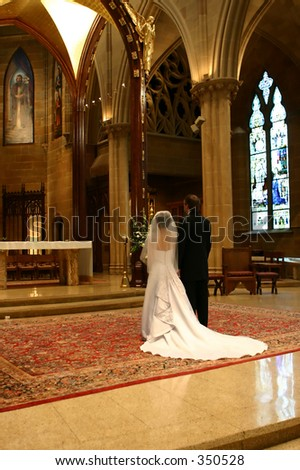 Bride and Groom at altar (portrait) - stock photo