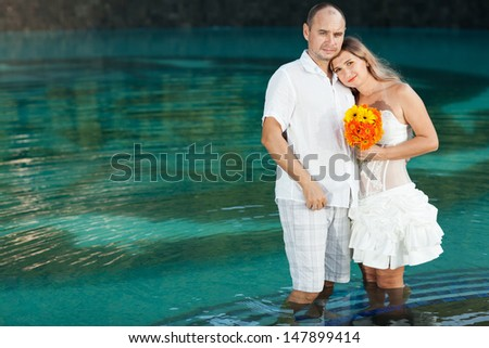Bride and groom at summer suunny day - stock photo