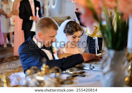 bride and groom at the altar - stock photo