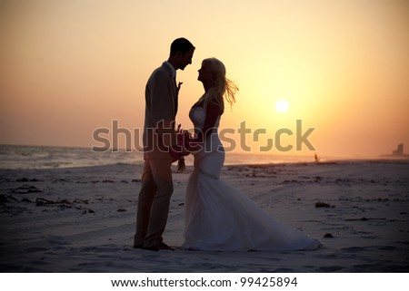 Bride and Groom at the Beach - stock photo