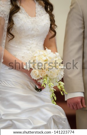 Bride and groom at the ceremony - stock photo