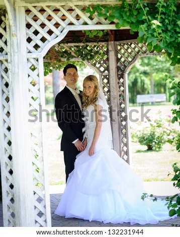 Bride and groom at the park - stock photo