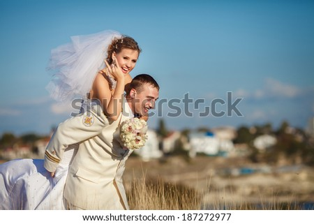 Bride and Groom at wedding Day Outdoors on nature-soft focus. Bridal couple, Happy Newlywed woman and man embracing outdoor. Loving wedding couple marriage.