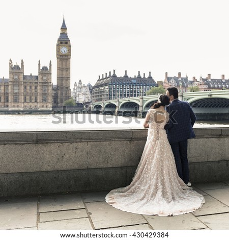 Bride and groom at Westminster bridge in London, England