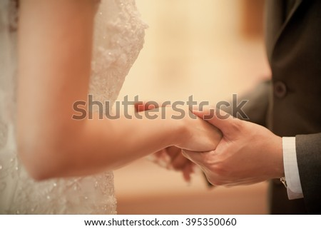 Bride and groom close up at wedding ceremony - stock photo