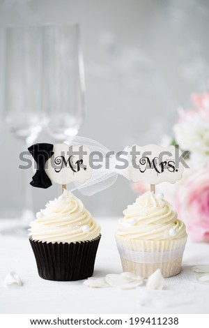 Bride and groom cupcakes  - stock photo