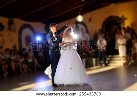bride and groom dancing on the own wedding